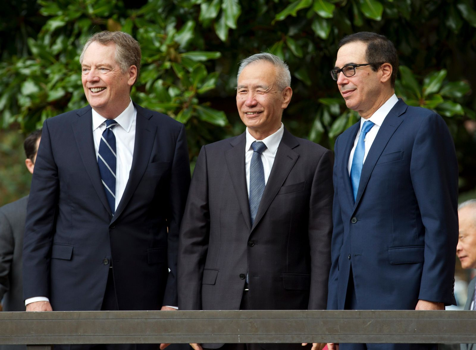 Chinese Vice Premier Liu He accompanied by U.S. Trade Representative Robert Lighthizer, left, and Treasury Secretary Steven Mnuchin, greets the media before a minister-level trade meetings at the Office of the United States Trade Representative in Washington, Thursday, Oct. 10, 2019. (AP Photo/Jose Luis Magana)