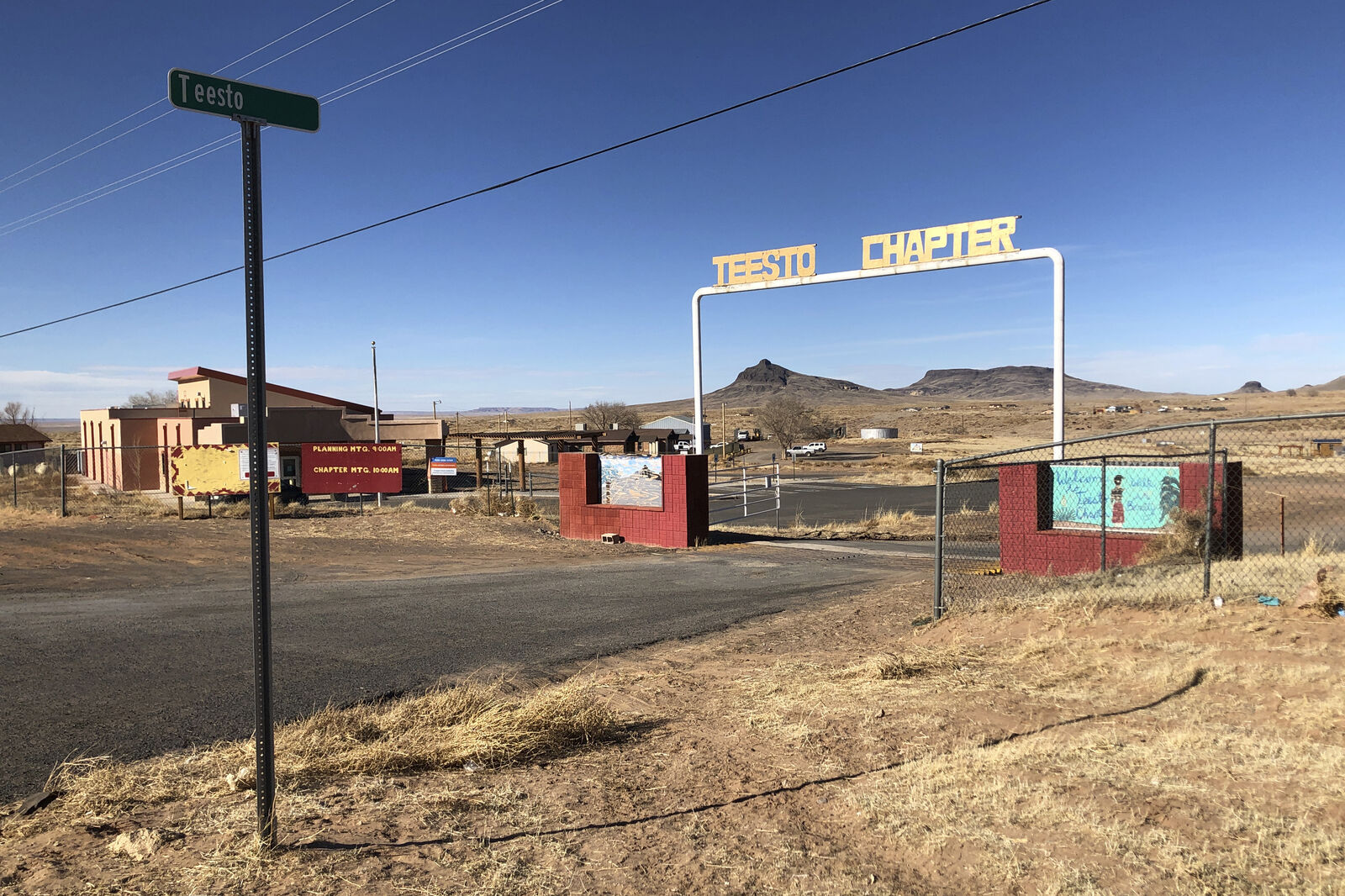 The entrance to the Teesto Chapter in Teesto, Ariz., on the Navajo Nation is seen on Feb. 11, 2021. Teesto workers, health representatives, volunteers and neighbors keep close tabs on another to ensure the most vulnerable citizens get the help they need. (AP Photo/Felicia Fonseca)