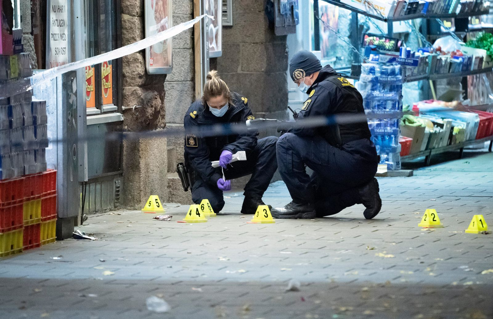 In this photo taken late Saturday, Nov. 9, 2019, police officers work near the scene of a shooting, in Malmo, Sweden. (Johan Nilsson/TT News Agency via AP)