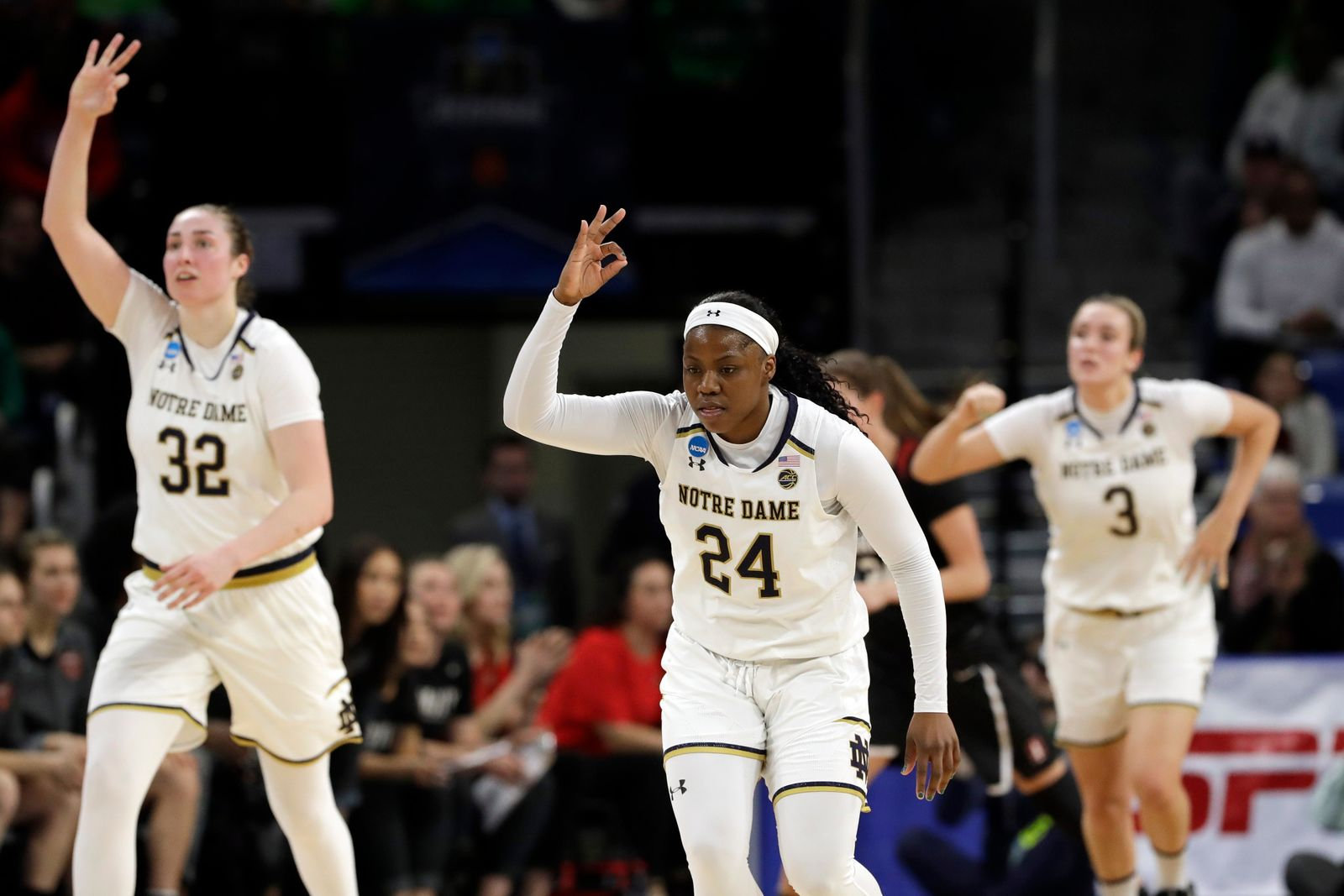Notre Dame's Arike Ogunbowale (24) reacts after shooting a 3-point shot during the first half of a regional championship game against Stanford in the NCAA women's college basketball tournament, Monday, April 1, 2019, in Chicago. (AP Photo/Nam Y. Huh)