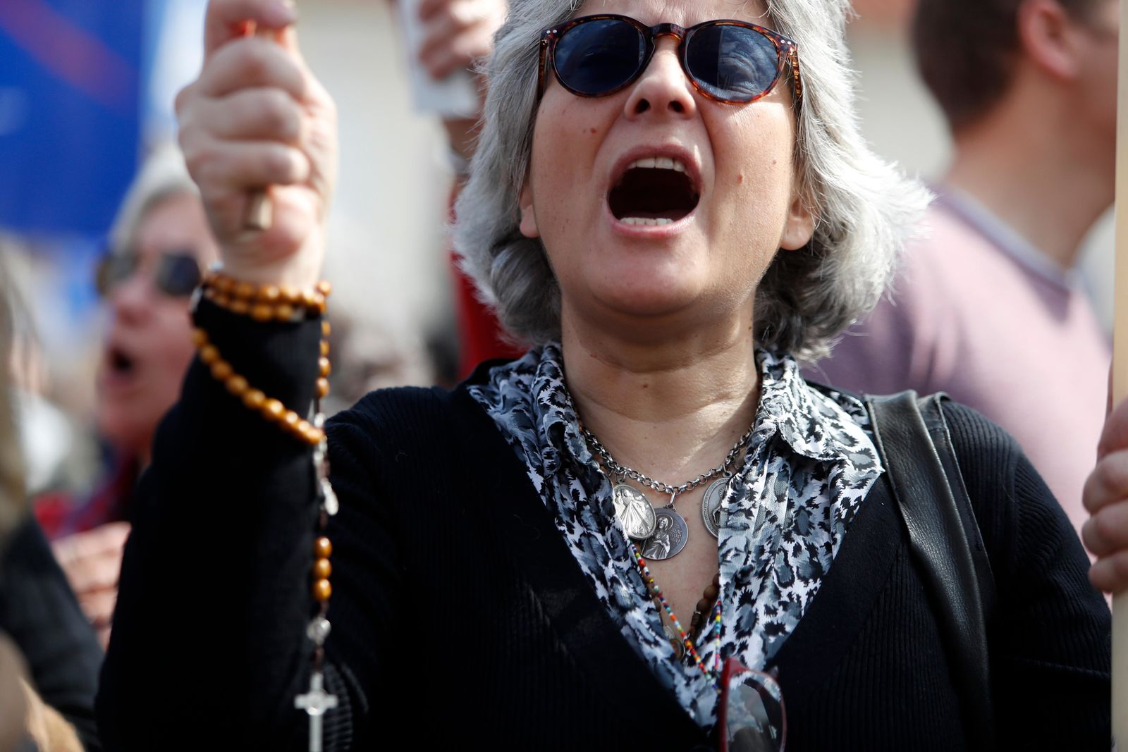 A demonstrator shouts slogans during a protest outside the Portuguese parliament in Lisbon, Thursday, Feb. 20, 2020. (AP Photo/Armando Franca)