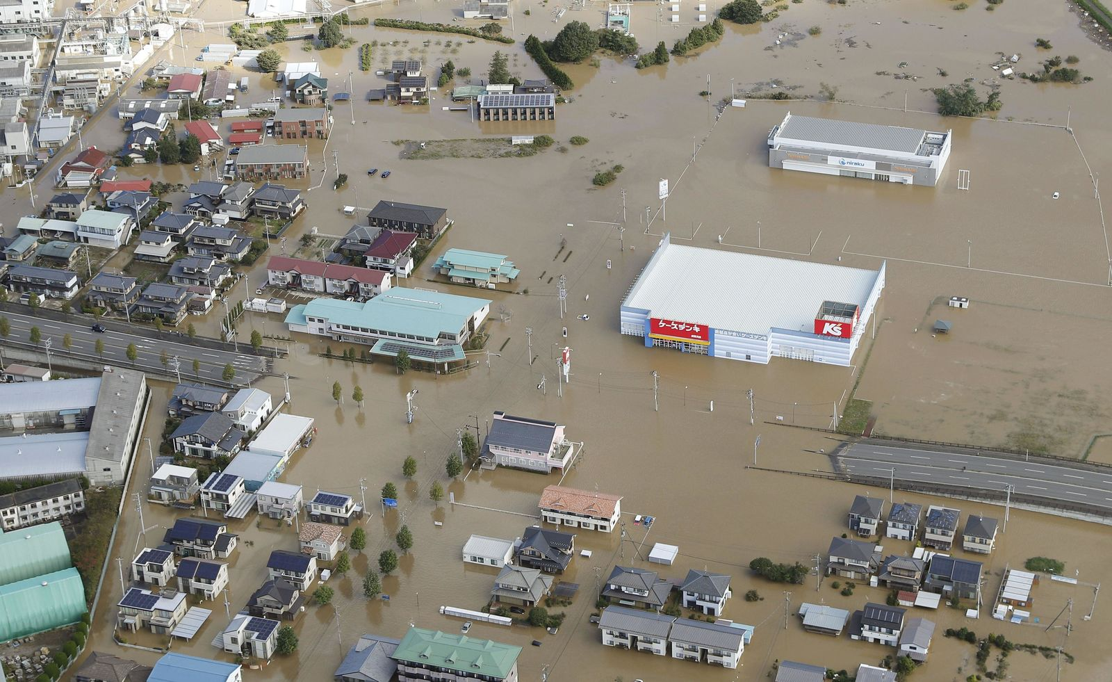 Houses are submerged in muddy waters in Sukagawa, Fukushima prefecture, as Typhoon Hagibis hits the area, northern Japan, Sunday, Oct. 13, 2019. (Takuya Inaba/Kyodo News via AP)