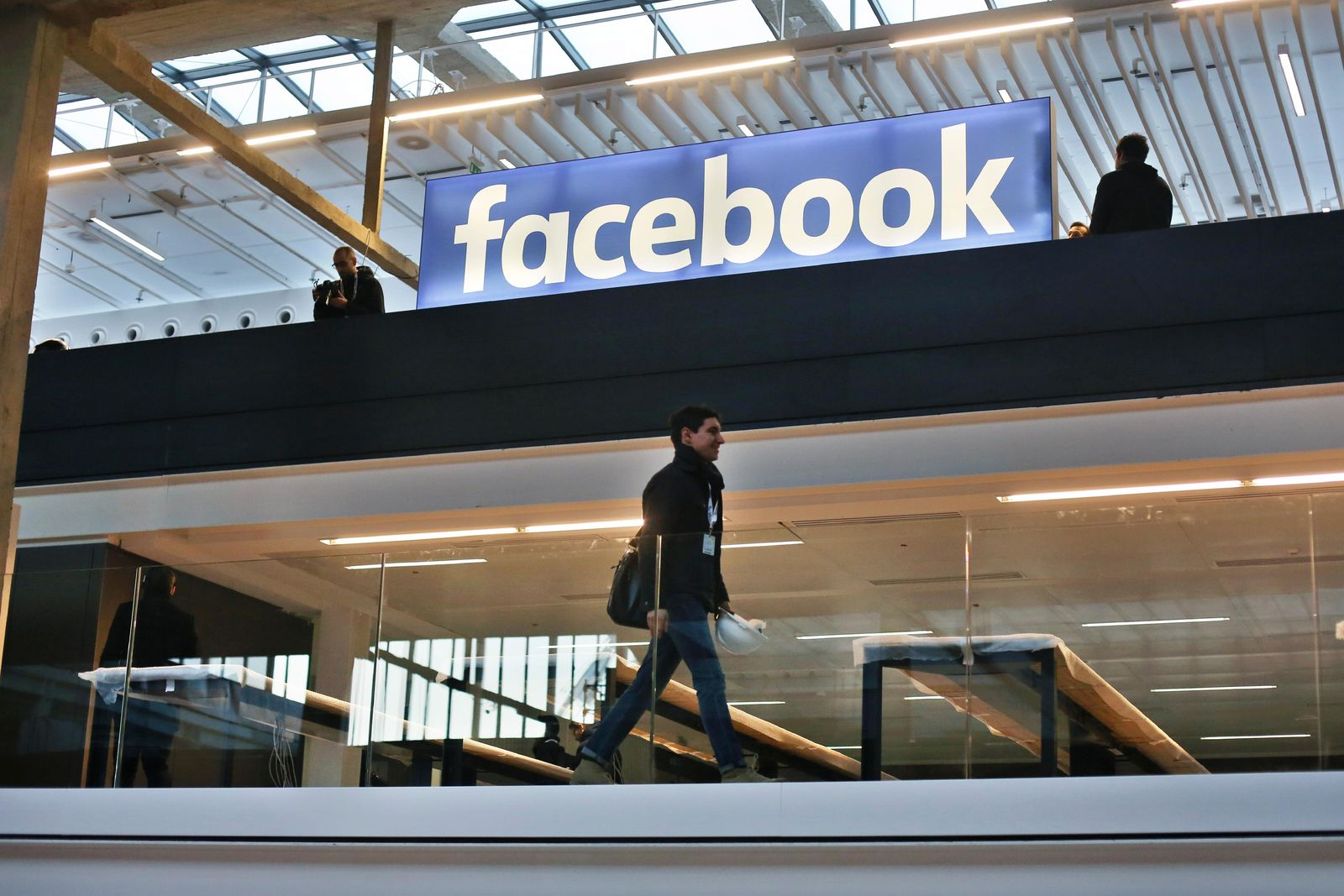 FILE - In this Jan.17, 2017 file photo, the Facebook logo is displayed in a start-up companies gathering at Paris' Station F, in Paris. France's lower house of parliament has approved a pioneering tax on internet giants like Google, Amazon and Facebook. The bill adopted Thursday by the National Assembly aims to stop multinationals from avoiding taxes by setting up headquarters in low-tax EU countries. (AP Photo/Thibault Camus, File)