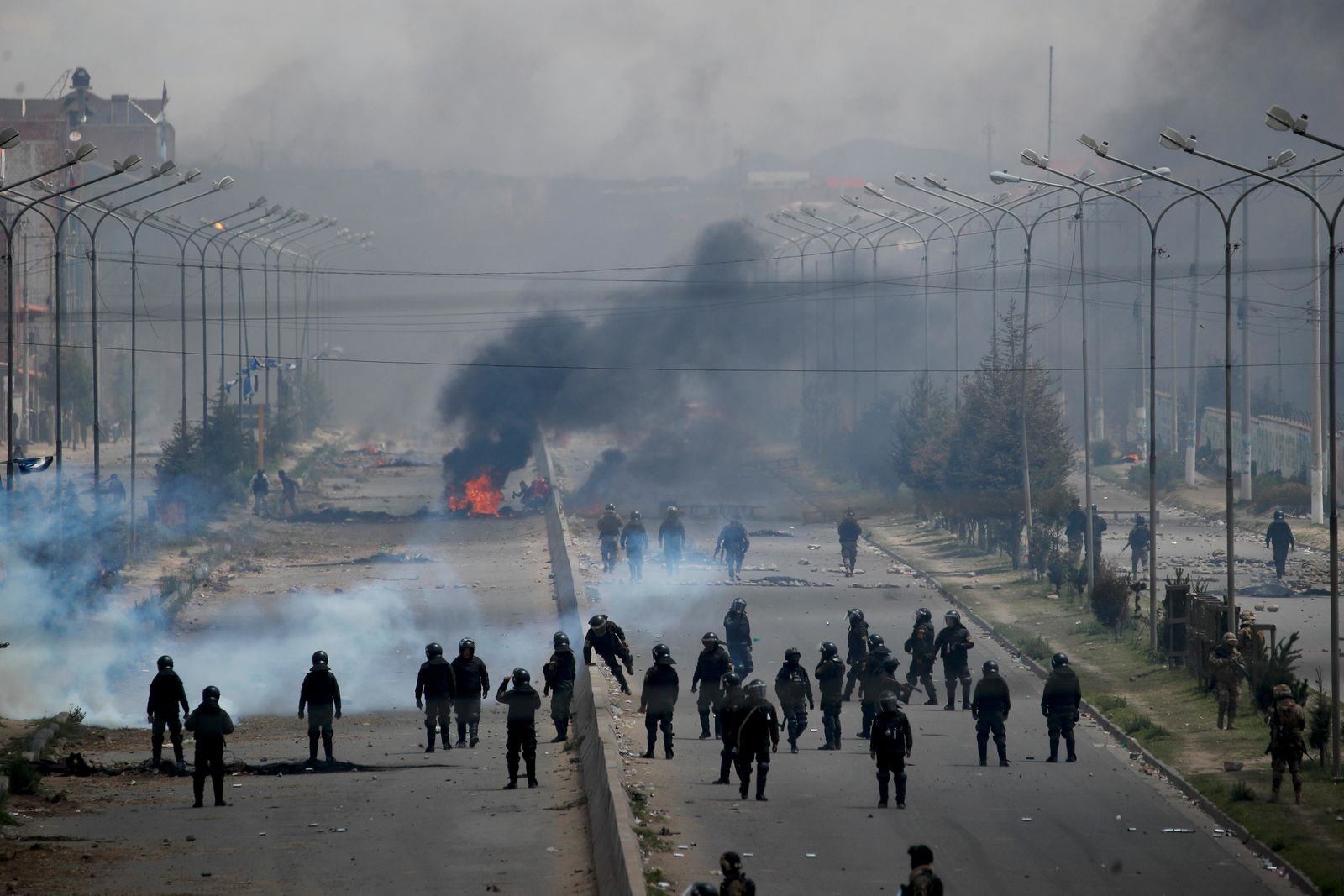 Security forces guard the road leading to a gas plant in El Alto, on the outskirts of La Paz, Bolivia, as supporters of former President Evo Morales set up barricades, Tuesday, Nov. 19, 2019. (AP Photo/Natacha Pisarenko)