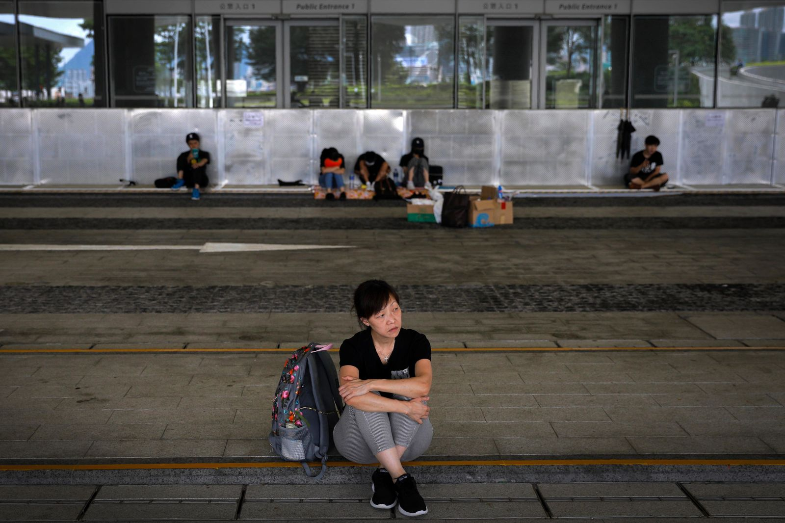 Protesters gather outside the Legislative Council following last weekend's massive protest against the unpopular extradition bill in Hong Kong, Tuesday, June 18, 2019. Hong Kong's government headquarters reopened Tuesday as the number of protesters outside dwindled to a few dozen and life returned to normal in the former British colony. (AP Photo/Vincent Yu)