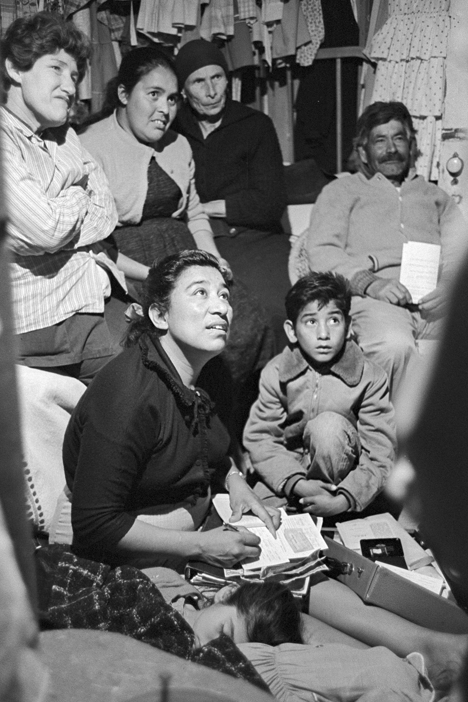 In this undated photo, labor leader Maria Moreno speaks with migrant farmworkers in rural California. (George Ballis/Take Stock via AP)