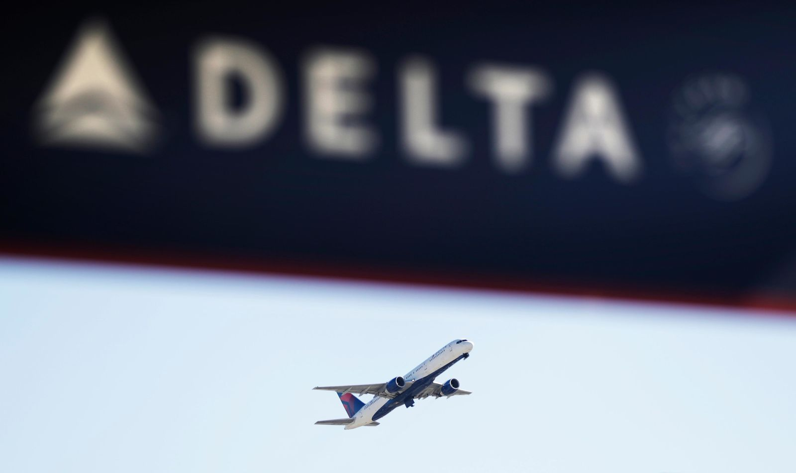 FILE - In this Jan. 30, 2017, file photo, a Delta Air Lines flight takes off from Hartsfield-Jackson International Airport in Atlanta. (AP Photo/David Goldman, File)