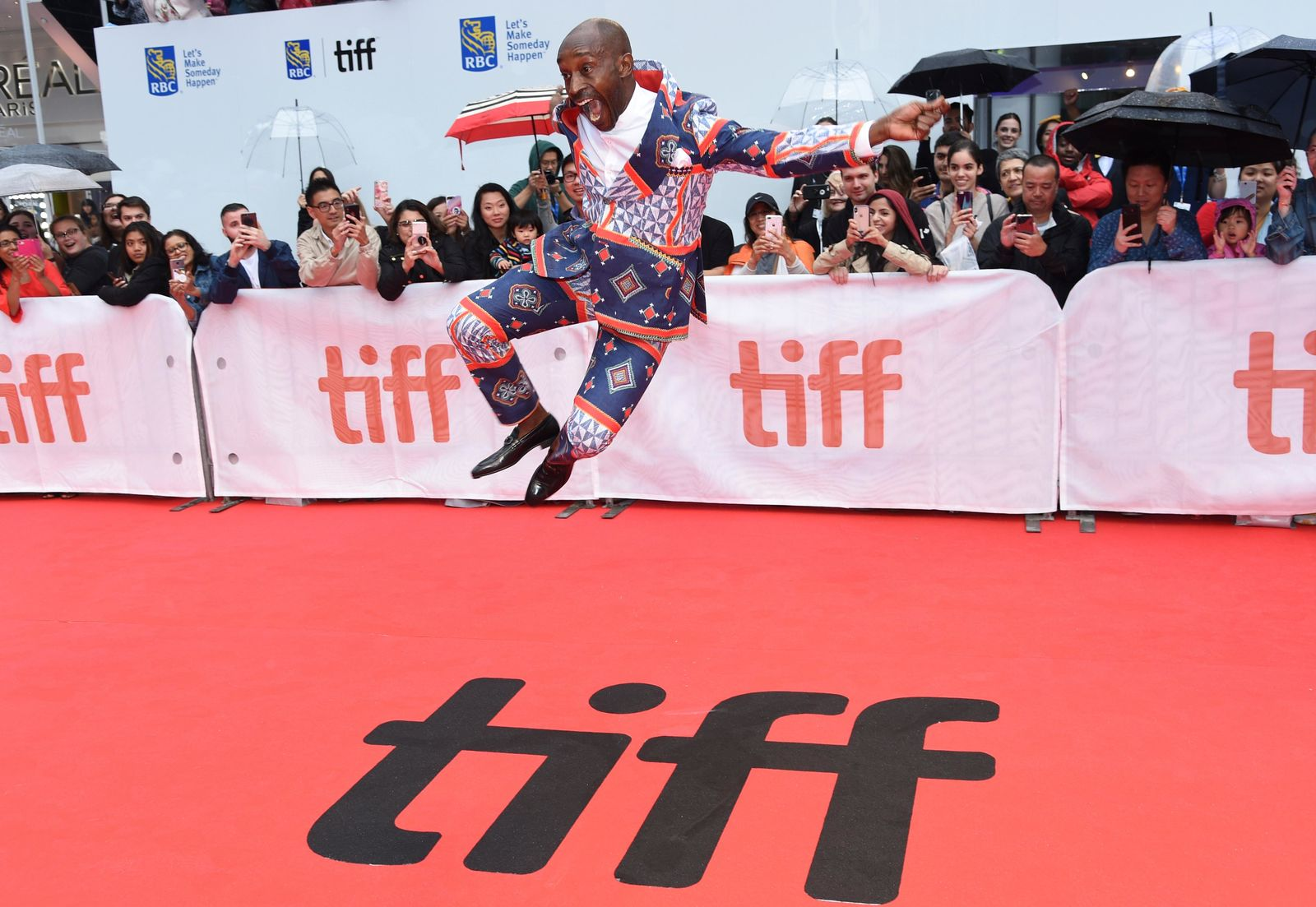 "Rob Morgan jumps on the red carpet as he attends the premiere for ""Just Mercy"" on day two of the Toronto International Film Festival at the Roy Thomson Hall on Friday, Sept. 6, 2019, in Toronto. (Photo by Chris Pizzello/Invision/AP)"