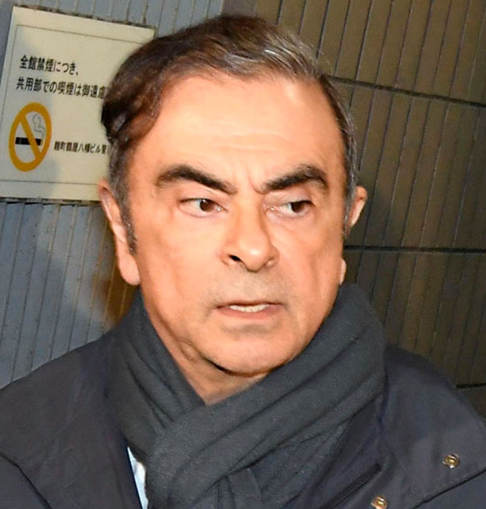 In this undated photo, former Nissan Chairman Carlos Ghosn leaves his lawyer's office in Tokyo. (Kyodo News via AP)