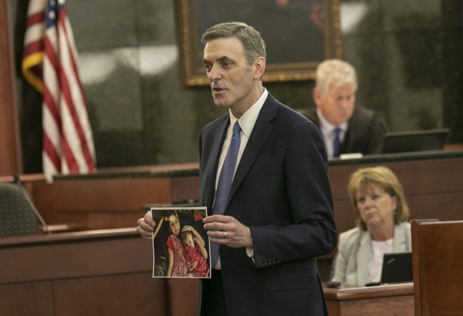 11th Circuit Solicitor Rick Hubbard delivers closing arguments, showing pictures of the Jones children during the sentencing phase of the trial of Timothy Jones Jr. in Lexington, S.C. on Thursday, June 13, 2019. (Tracy Glantz/The State via AP, Pool)
