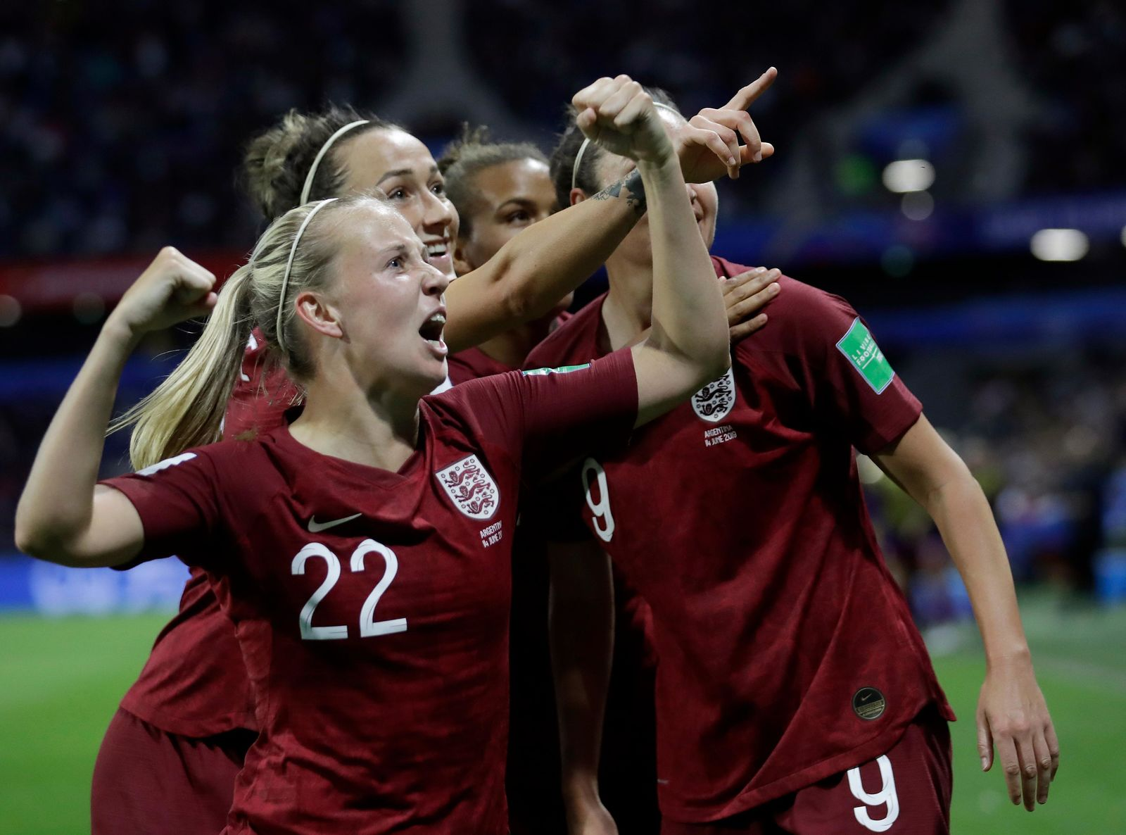 England's Beth Mead, front, celebrates after her teammate Jodie Taylor scored the opening goal during the Women's World Cup Group D soccer match between England and Argentina at the Stade Oceane in Le Havre, France, Friday, June 14, 2019. (AP Photo/Alessandra Tarantino)