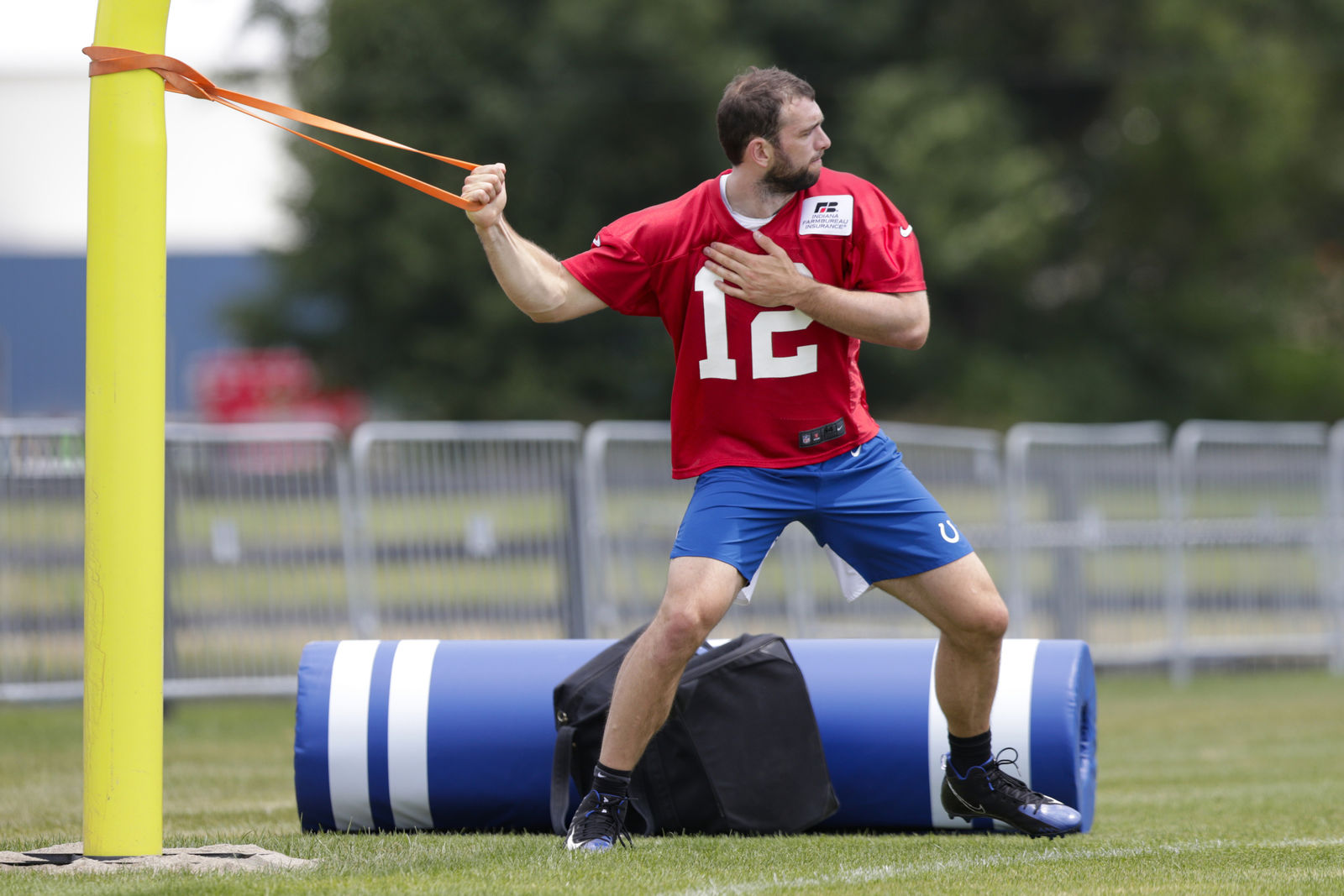 "FILE - In this July 26, 2019, file photo, Indianapolis Colts quarterback Andrew Luck warms up during practice at the NFL team's football training camp in Westfield, Ind. If Luck keeps progressing, then the questions will turn into how soon can he play? ""We won't as an organization, put any player out there that can't perform at a high level,"" general manager Chris Ballard said. ""I'm not going to put players at risk. So if we feel comfortable, Frank and I and our staff feel comfortable that he can play, then he'll play."" (AP Photo/Michael Conroy, File)"