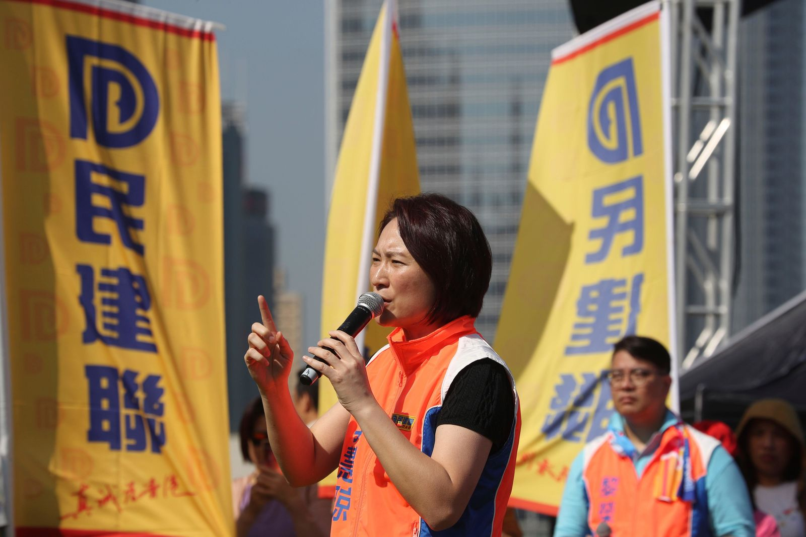 Starry Lee, head of the Democratic Alliance for the Betterment and Progress of Hong Kong, speaks during an event for the party's candidates in the upcoming district elections held in Hong Kong on Thursday, Nov. 21, 2019.{ } (AP Photo/Ng Han Guan)