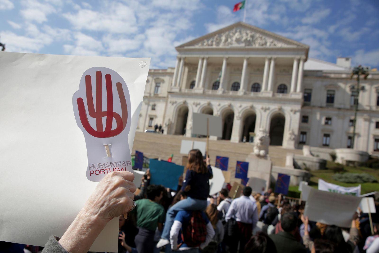 Demonstrators protest outside the Portuguese parliament in Lisbon, Thursday, Feb. 20, 2020. (AP Photo/Armando Franca)