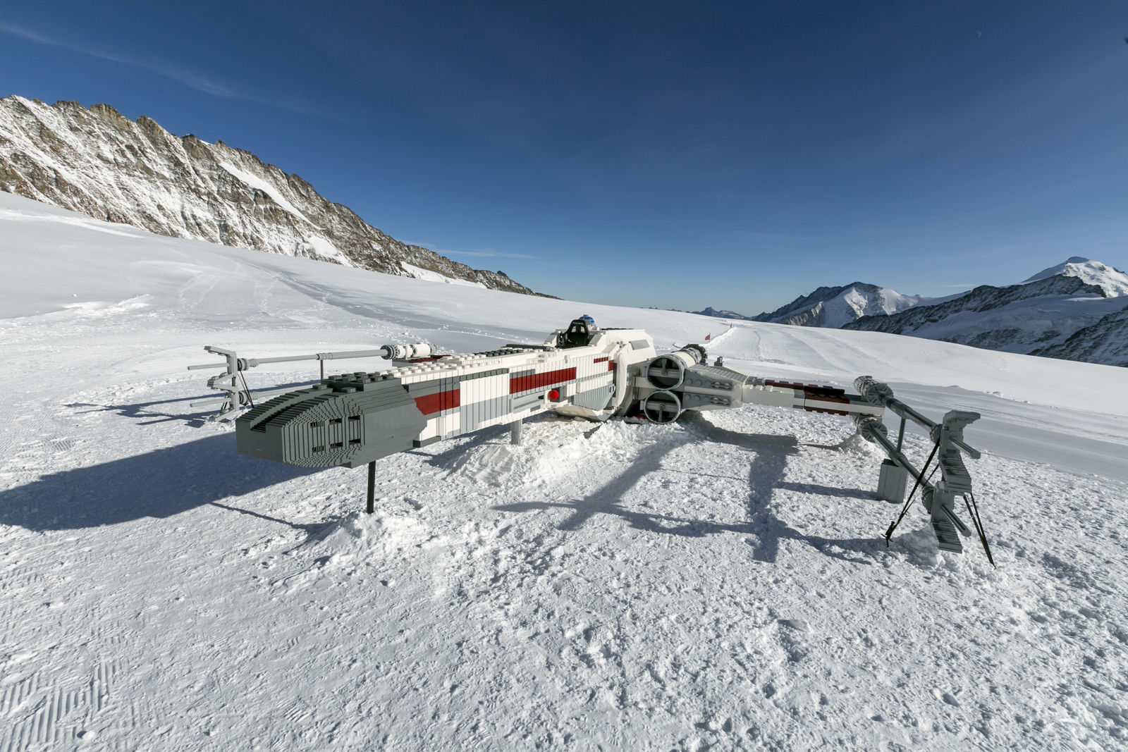 "GRINDELWALD, SWITZERLAND - OCTOBER 03: A LEGO Star Wars X-Wing Starfighter is build up at the Jungfraujoch 'Top of  Europe' in Switzerland ahead of ""Triple Force Friday"" on October 03, 2019, near Grindelwald, Switzerland. The lifesize LEGO Star Wars X-Wing Starfighter is built out of 2,5 million LEGO bricks and has a size of 10 x 10 meter.  (Photo by Jan Hetfleisch/Getty Images for the LEGO Group)"