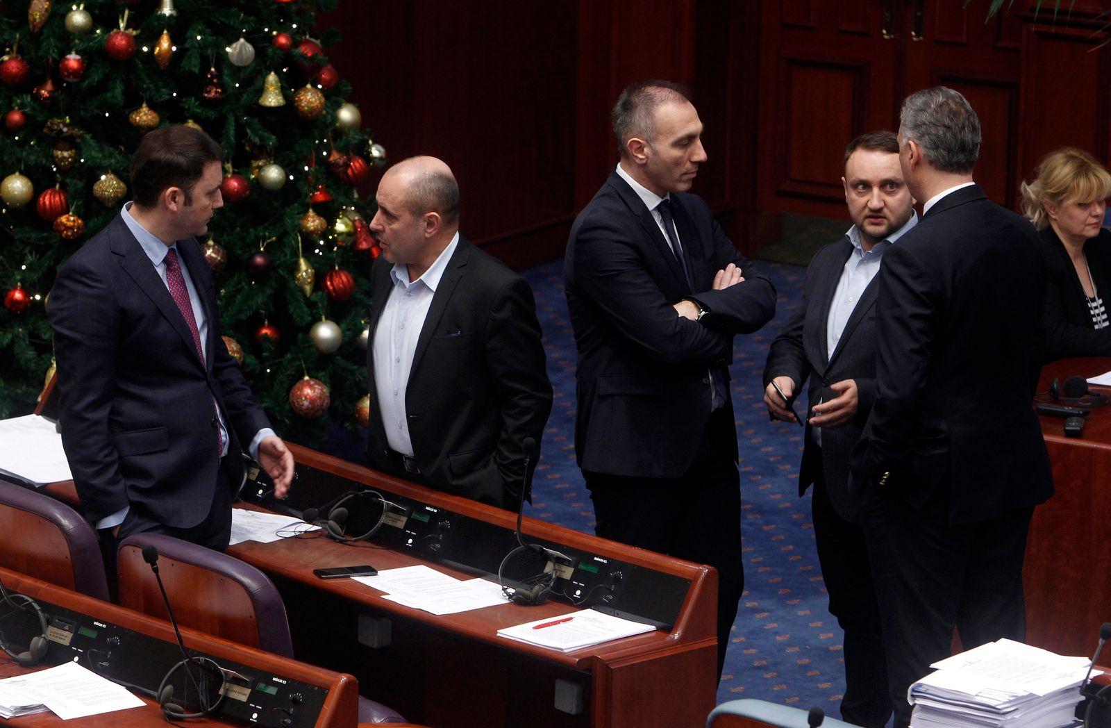 Lawmakers talk between themselves before a session of the Macedonian Parliament in the capital Skopje, Wednesday, Jan. 9, 2019. (AP Photo/Bor