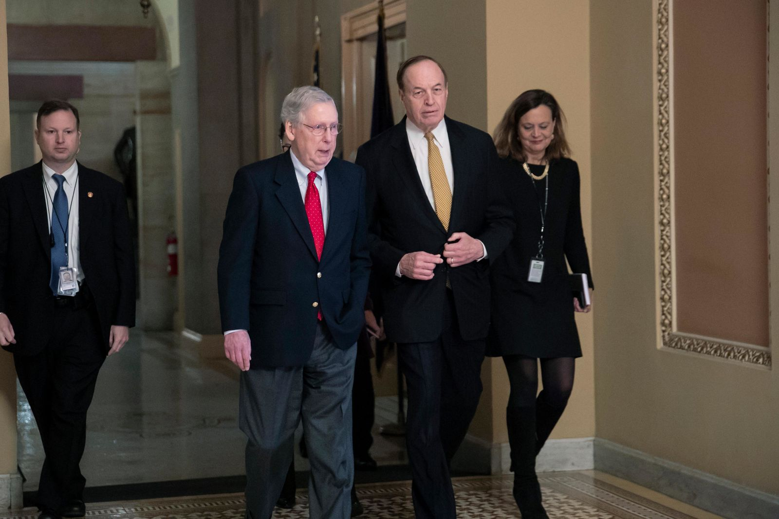 En route to a meeting at the White House, Senate Majority Leader Mitch McConnell, R-Ky., left, walks with Sen. Richard C. Shelby, R-Ala. (AP Photo/J. Scott Applewhite)