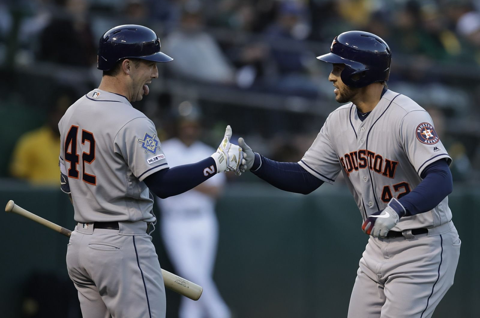Houston Astros' George Springer, right, celebrates with Alex Bregman after hitting a home run off Oakland Athletics' Marco Estrada in the first inning of a baseball game, Tuesday, April 16, 2019, in Oakland, Calif. (AP Photo/Ben Margot)