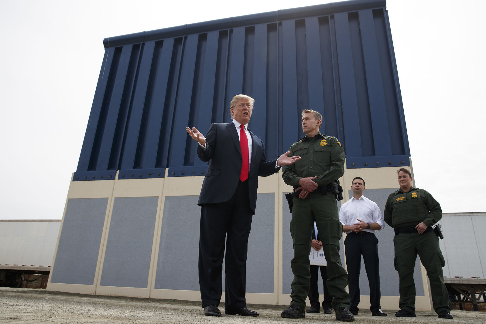 FILE - In this March 13, 2018, file photo, President Donald Trump talks with reporters as he reviews border wall prototypes in San Diego. California's attorney general filed a lawsuit Monday, Feb. 18, 2019, against Trump's emergency declaration to fund a wall on the U.S.-Mexico border. (AP Photo/Evan Vucci, File)