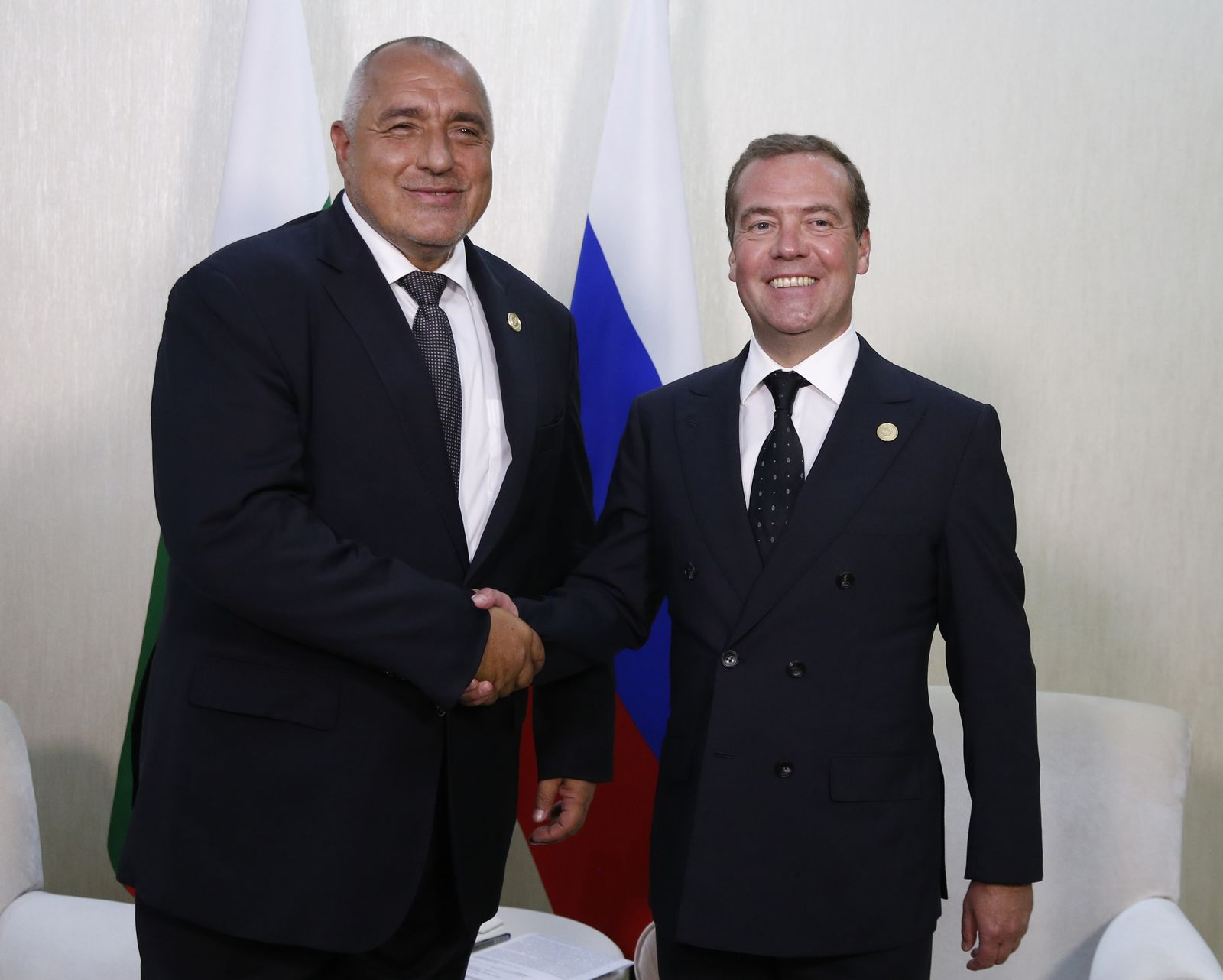 Russian Prime Minister Dmitry Medvedev, right, and Bulgarian Prime Minister Boyko Borissov pose for a photo at the First Caspian Economic Forum in Turkmenbashi, Turkmenistan, Monday, Aug. 12, 2019. (Dmitry Astakhov, Sputnik, Government Pool Photo via AP)