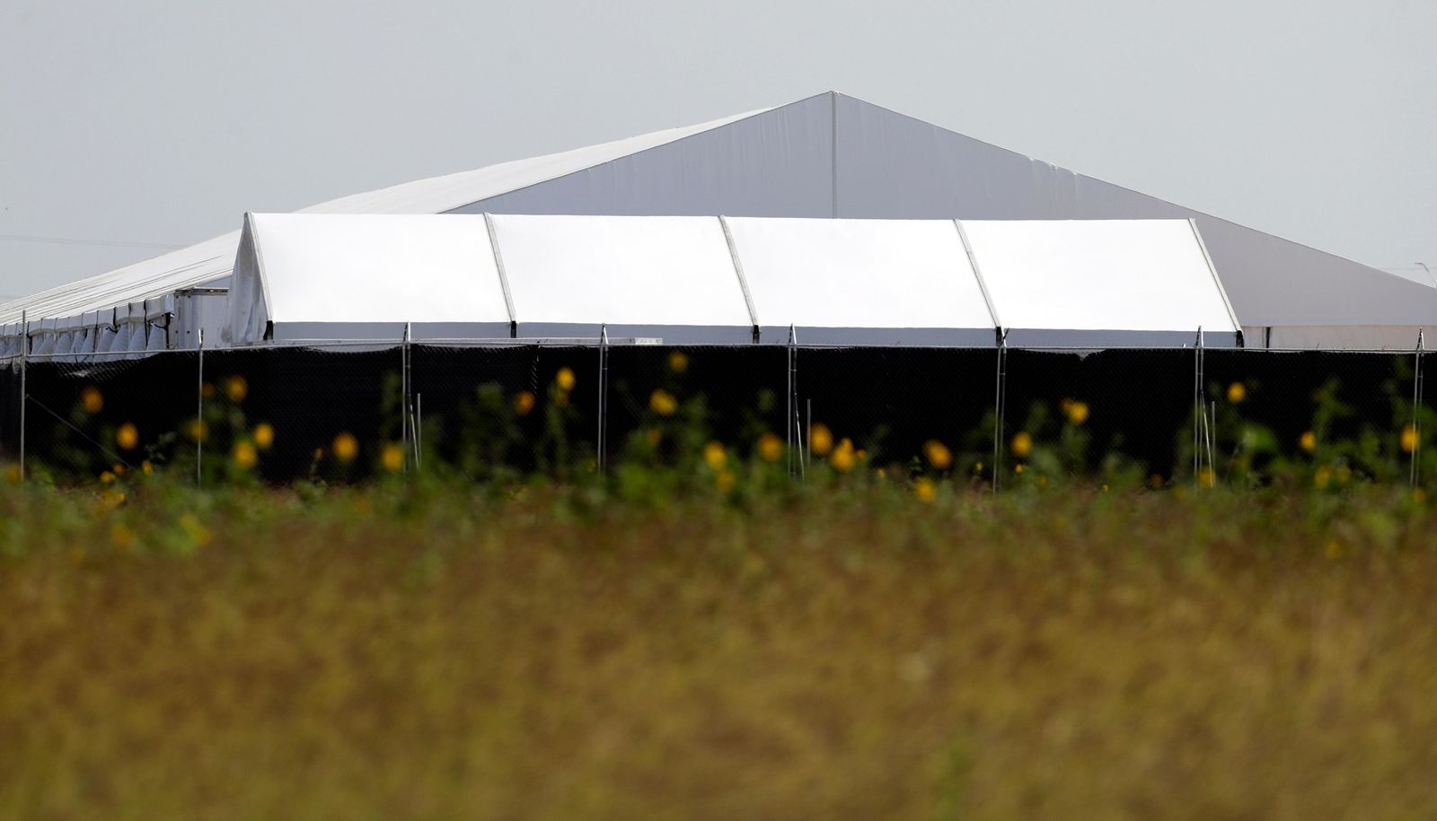 In this May 1, 2019, photo, a U.S. Customs and Border Protection temporary facility is prepared near the Donna International Bridge in Donna, Texas. (AP Photo/Eric Gay)