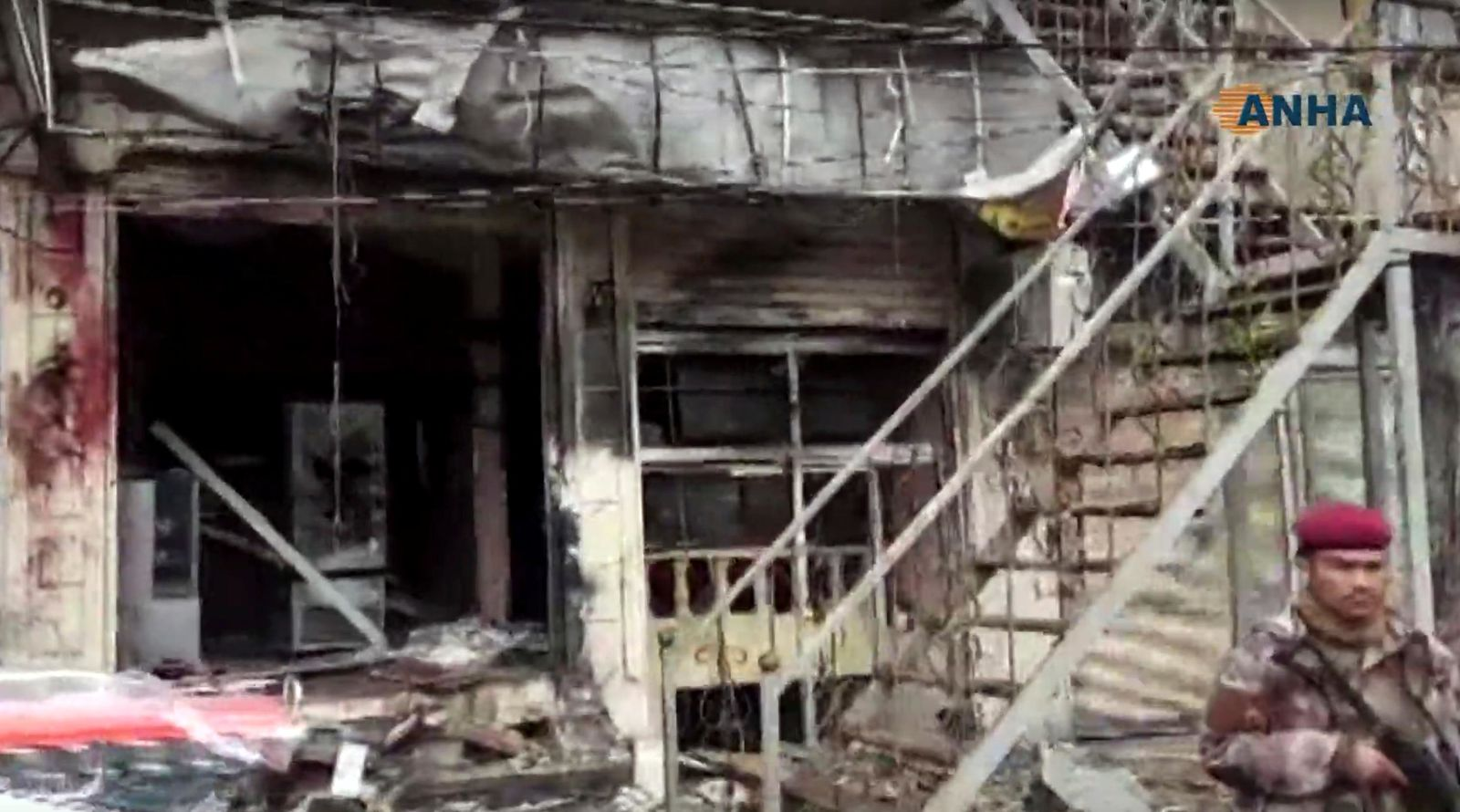 This frame grab from video provided by Hawar news, the news agency for the semi-autonomous Kurdish areas in Syria (ANHA), shows the damaged restaurant where explosion occurred near a patrol of the U.S.-led coalition, in Manbij town, Syria, Wednesday, Jan. 16, 2019.{ } (ANHA via AP)