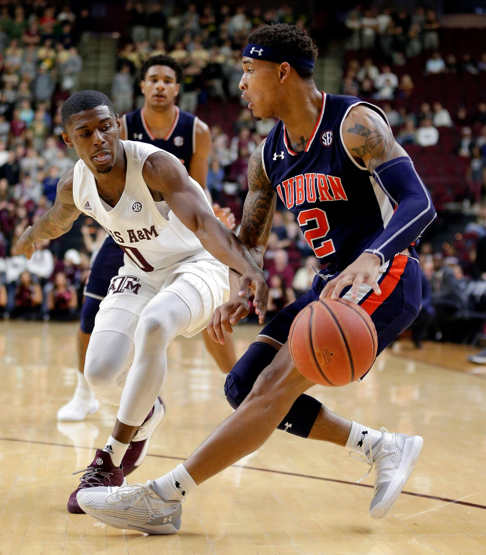 Auburn guard Bryce Brown (2) looks to drive around Texas A&M guard Jay Jay Chandler (0) as he reaches in for the ball during the second half of an NCAA college basketball game, Wednesday, Jan. 16, 2019, in College Station, Texas. (AP Photo/Michael Wyke)