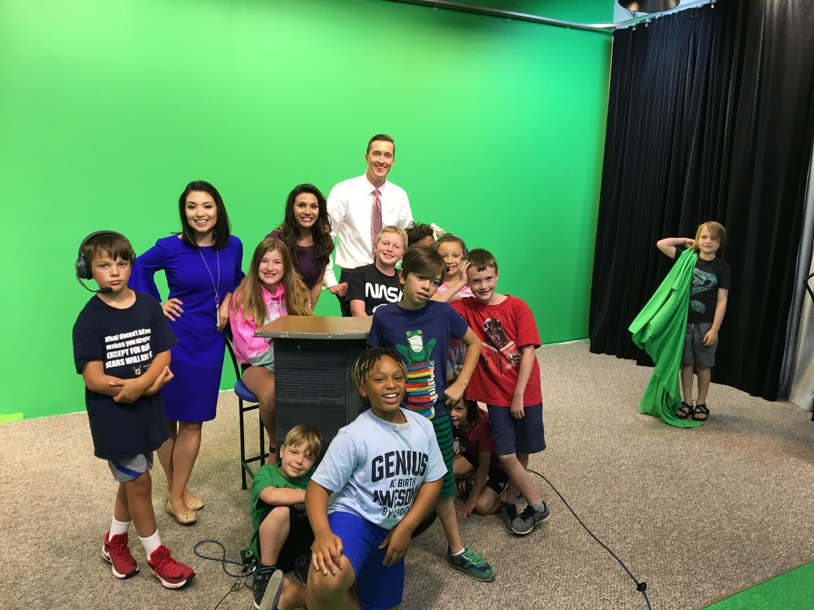 About a dozen students from{ }Public Media Network's summer youth program learned television journalism skills from Newschannel 3's{ }morning anchor/reporter Erica Mokay, weekend meteorologist/reporter Will Haenni, and evening anchor/reporter Lora Painter. (WWMT/Lora Painter)