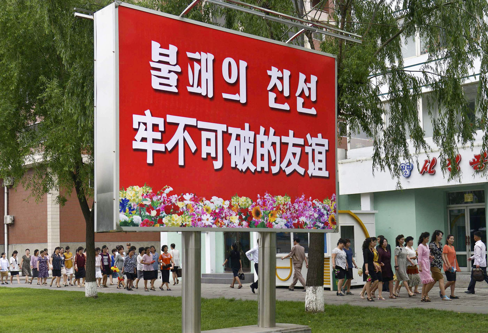 "The signboard, which reads ""Unbreakable friendship"" in Chinese and Korean language respectively, is displayed in Pyongyang, North Korea, Thursday, June 20, 2019. (Kyodo News via AP)"