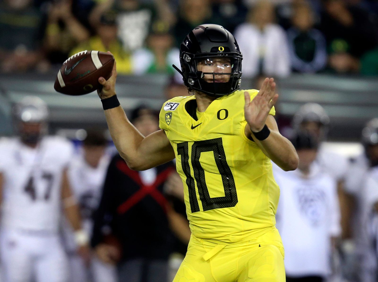 Oregon's Justin Herbert drops back to pass during the first quarter of an NCAA college football game against Montana Saturday, Sept. 14, 2019, in Eugene, Ore. (AP Photo/Chris Pietsch)