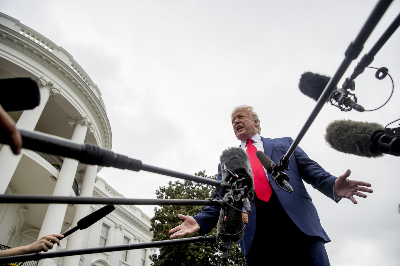 President Donald Trump speaks to the media on the South Lawn of the White House in Washington, Thursday, Oct. 3, 2019, before boarding Marine One for a short trip to Andrews Air Force Base, Md., and then on to Florida. (AP Photo/Andrew Harnik)
