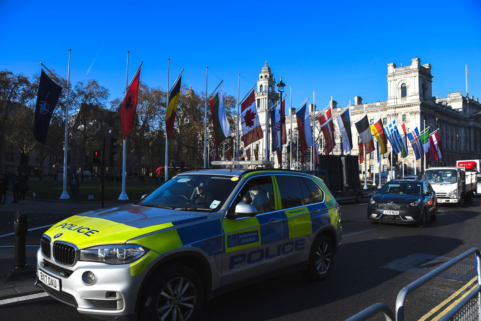 A police car drives past Parliament Square, ahead of the NATO summit, in London, Monday, Dec. 2, 2019.{ } (AP Photo/Alberto Pezzali)