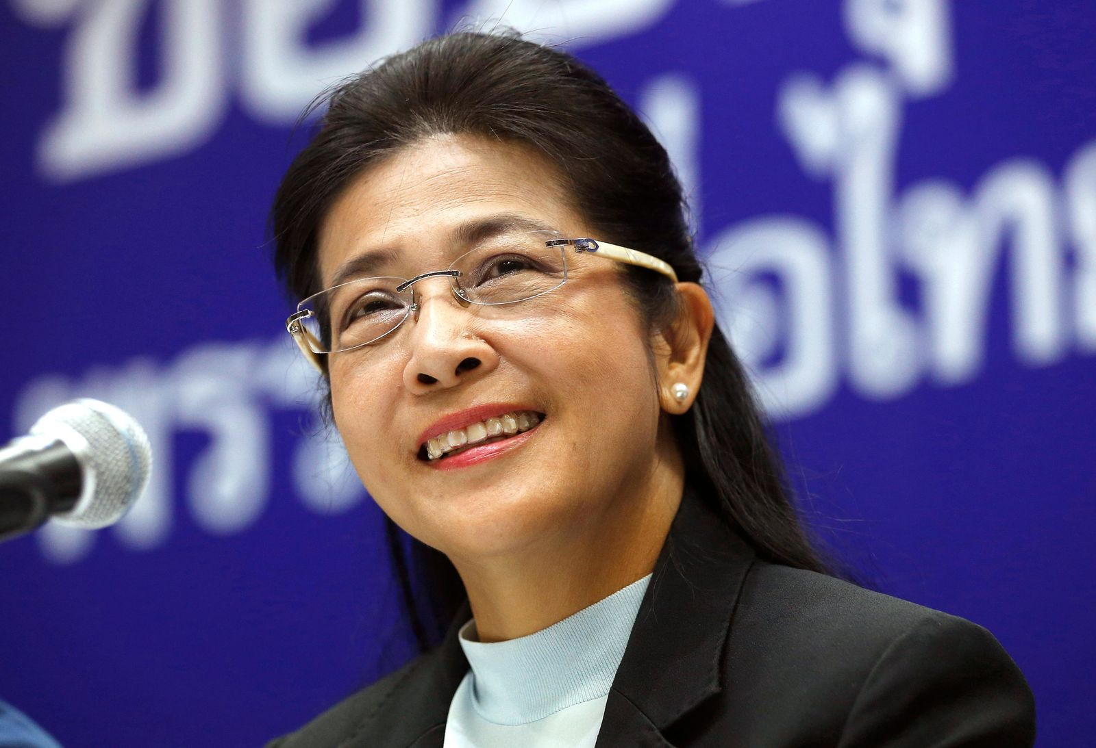 Pheu Thai party leader Sudarat Keyuraphan smiles during a press conference at the party headquarters in Bangkok, Thailand, Monday, March 25, 2019. Thailand's Election Commission said it will announce the results of 350 constituency seats on Monday but full vote counts, which are needed to determine the allocation of 150 other seats in the House of Representatives, won't be available until Friday. (AP Photo/Sakchai Lalit)