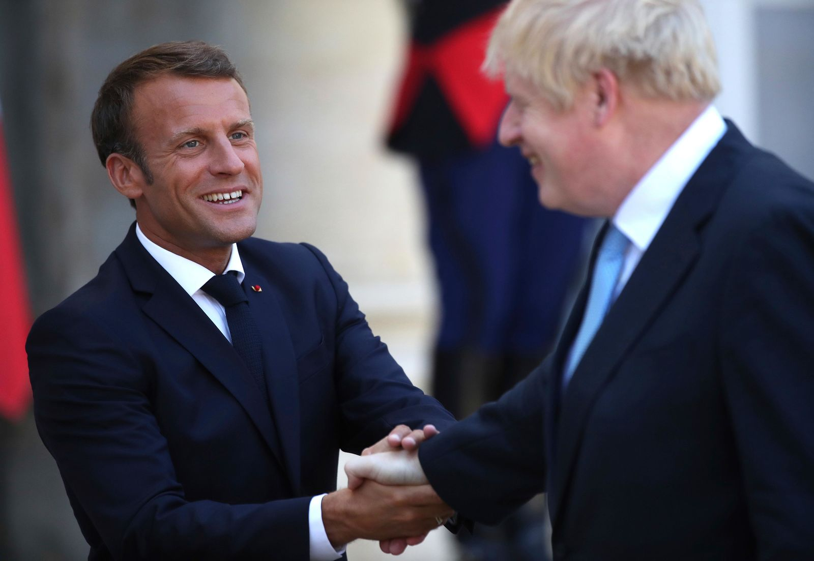 French President Emmanuel Macron bids farewell to Britain's Prime Minister Boris Johnson at the Elysee Palace, Thursday, Aug. 22, 2019 in Paris.{ } (AP Photo/Daniel Cole)