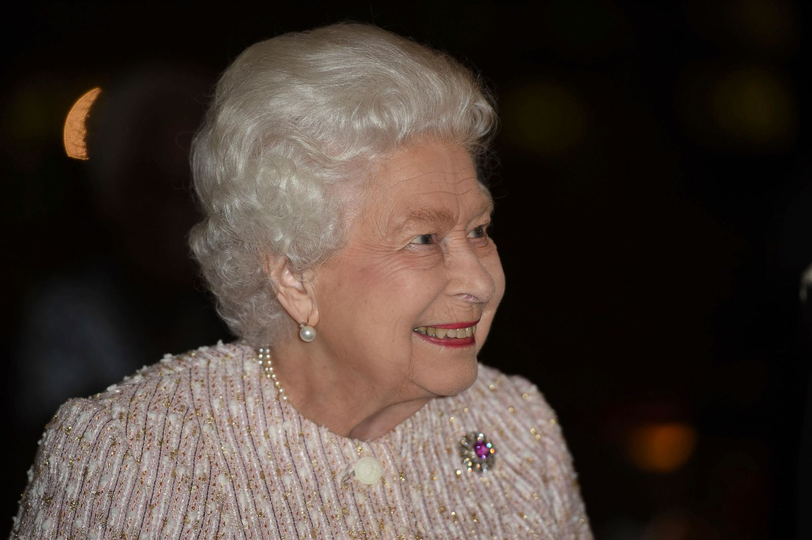 Britain's Queen Elizabeth II smiles as she arrives at the Royal institute of International Affairs in Chatham House, London, Wednesday Nov. 20, 2019. (Eddie Mulholland, Pool via AP)