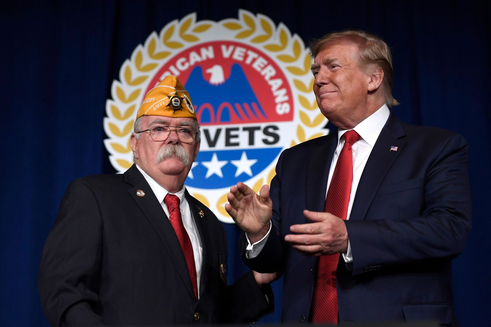 President Donald Trump stands with AMVETS national commander Rege Riley at the American Veterans (AMVETS) 75th National Convention in Louisville, Ky., Wednesday, Aug. 21, 2019. (AP Photo/Susan Walsh)