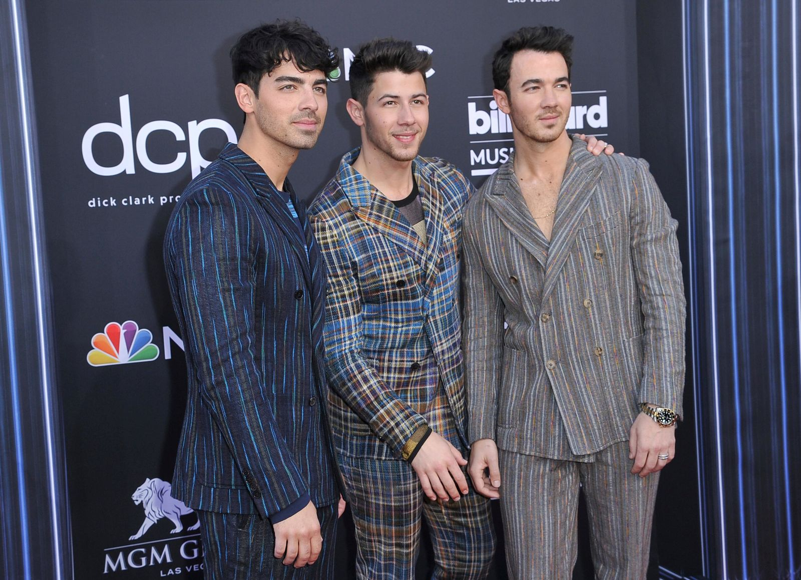 Joe Jonas, from left, Nick Jonas, and Kevin Jonas, of Jonas Brothers, arrive at the Billboard Music Awards on Wednesday, May 1, 2019, at the MGM Grand Garden Arena in Las Vegas. (Photo by Richard Shotwell/Invision/AP)