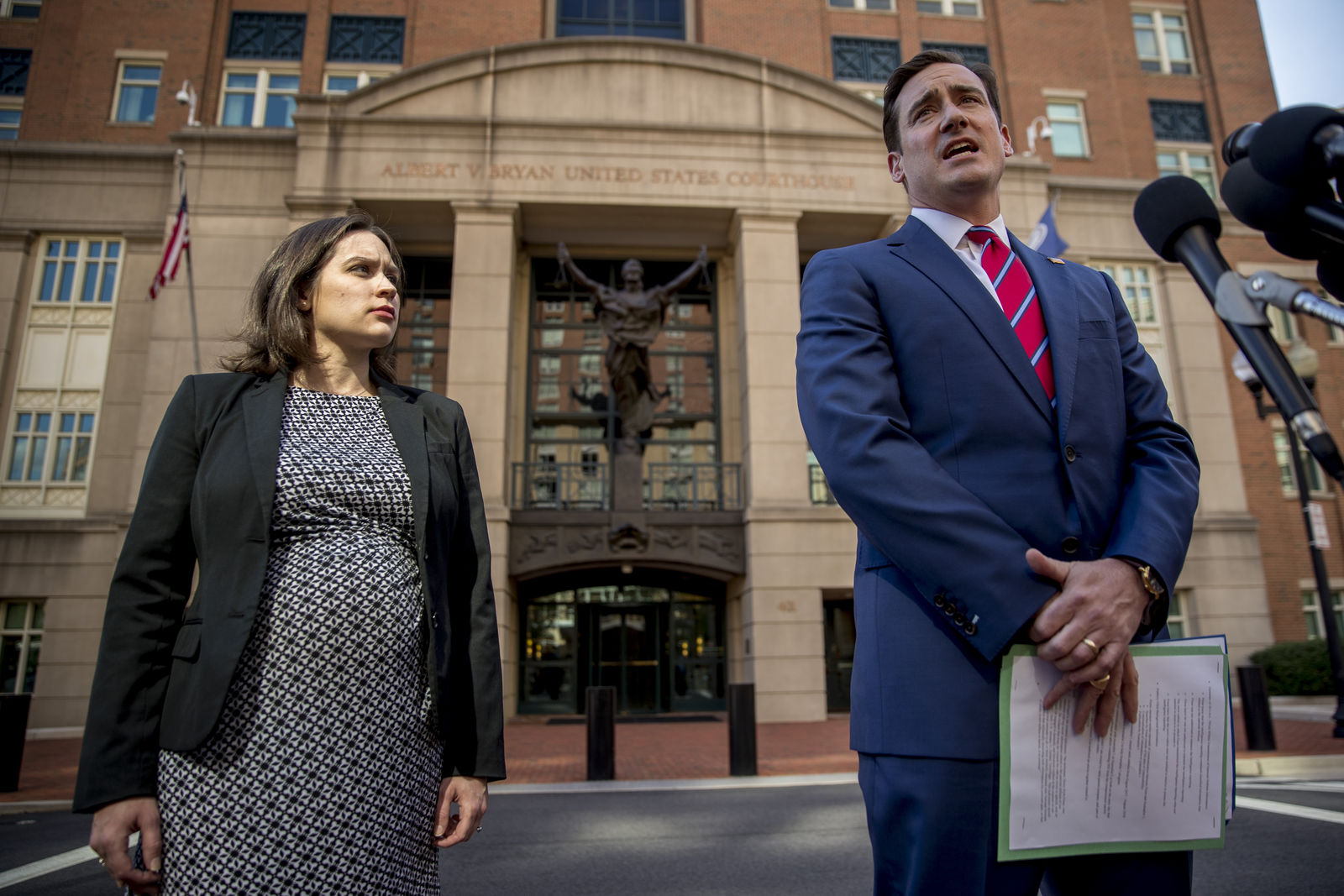 Attorney General for the Eastern District of Virginia G. Zachary Terwilliger, right, accompanied by Assistant United States Attorney Danya Atiyeh, left, takes a question from a reporter after announcing the arrest of Henry Kyle Frese, a Defense Intelligence Agency official in Alexandria, Va., Wednesday, Oct. 9, 2019. (AP Photo/Andrew Harnik)