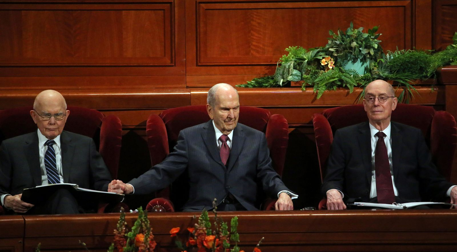 President Russell M. Nelson, center, sits with his counselors, Dallin H. Oaks, left, and Henry B. Eyring, right, during the The Church of Jesus Christ of Latter-day Saints conference Saturday, April 6, 2019, in Salt Lake City. Church members are preparing for more changes as they gather in Utah for a twice-yearly conference to hear from the faith's top leaders. (AP Photo/Rick Bowmer)