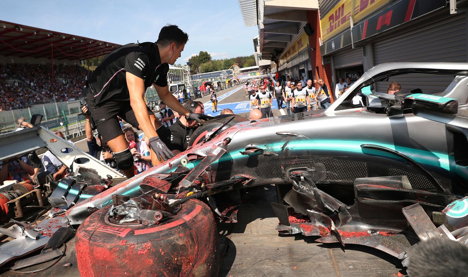 Pit crew inspect the damaged car of Mercedes driver Lewis Hamilton of Britain after Hamilton hit a barrier during the third practice session ahead of the Belgian Formula One at Spa-Francorchamps, Belgium, Saturday, Aug. 31, 2019.{ } (AP Photo/Francisco Seco)