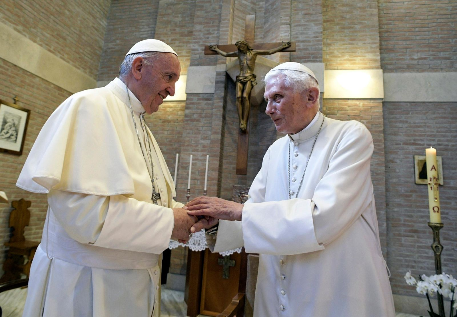 FILE - In this June 28, 2017, file photo, Pope Francis, left, and Pope Benedict XVI, meet each other on the occasion of the elevation of five new cardinals at the Vatican.{ } (L'Osservatore Romano/Pool photo via AP, File)