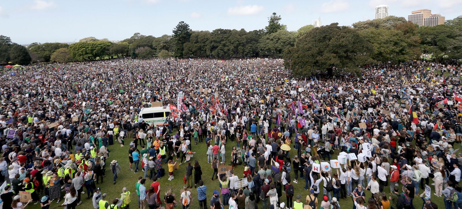 Thousands of protestors, many of them school students, gather in Sydney, Friday, Sept. 20, 2019, calling for action to guard against climate change.{ } (AP Photo/Tiger Balsmeyer)