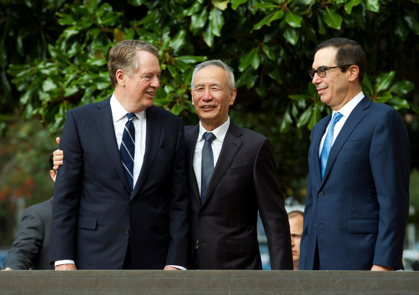 Chinese Vice Premier Liu He accompanied by U.S. Trade Representative Robert Lighthizer, left, and Treasury Secretary Steven Mnuchin, greets the media before a minister-level trade meeting in Washington, Thursday, Oct. 10, 2019. (AP Photo/Jose Luis Magana)