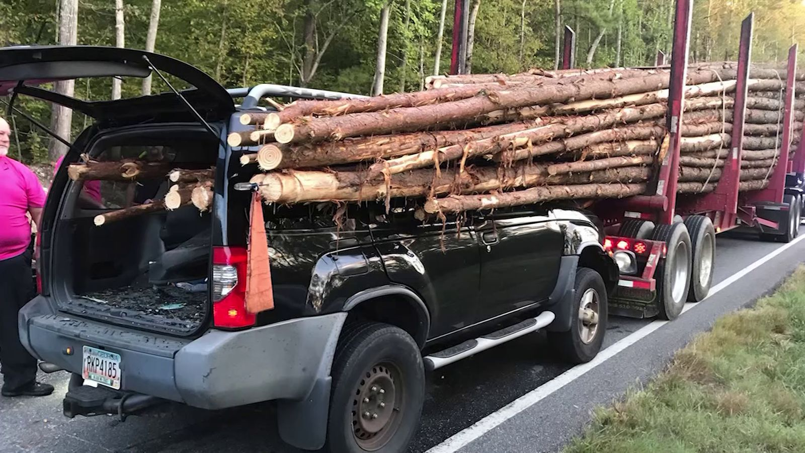 Man survives wreck with log truck after car impaled by logs. (Whitfield County Fire Department)