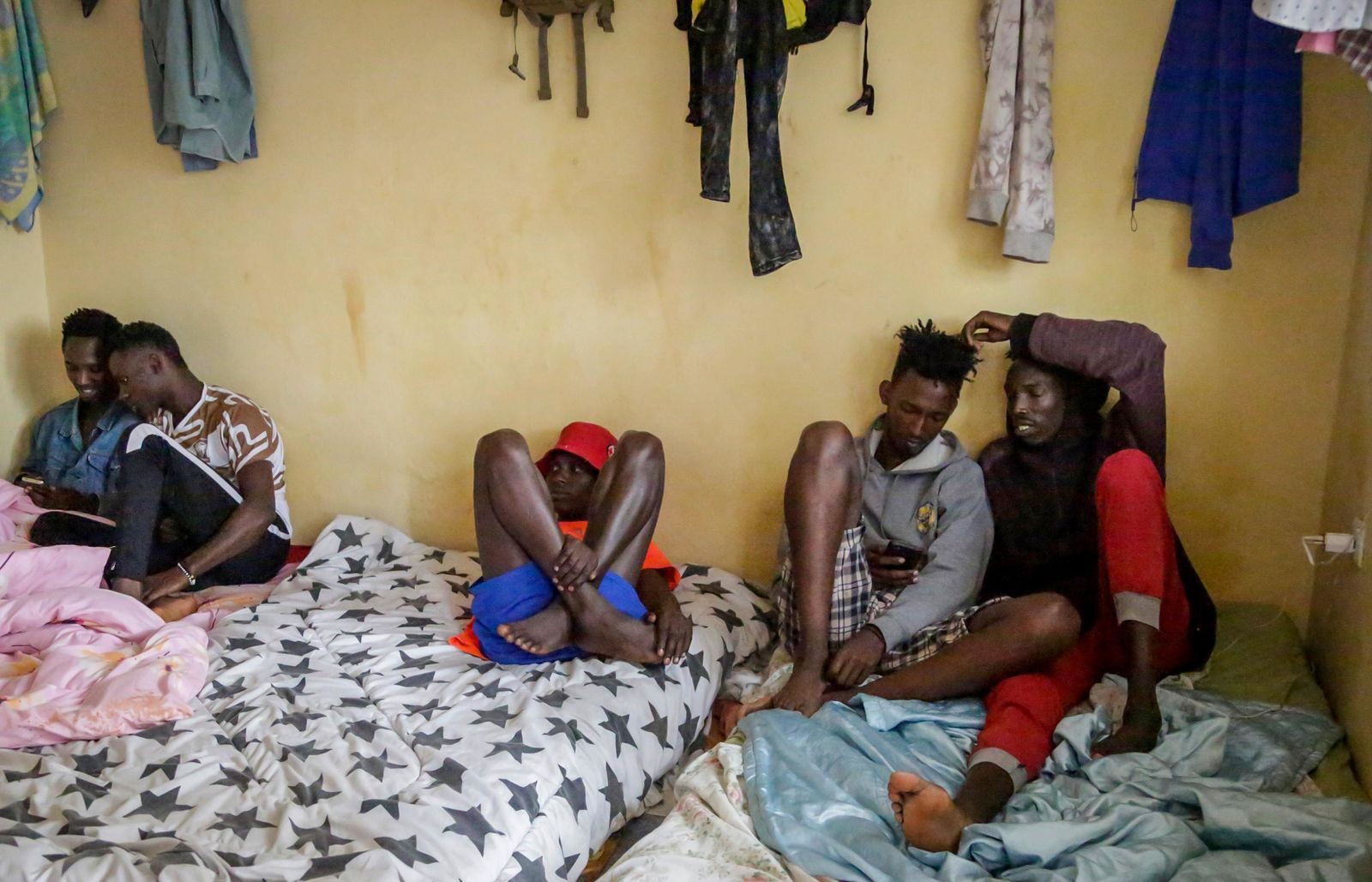 In this photo taken Tuesday, May 28, 2019, LGBT refugees from Burundi, Rwanda and Congo lie on a mattress in one of the rooms they share in the house where they take shelter in a low-income neighborhood of the capital Nairobi, Kenya. (AP Photo/Khalil Senosi)