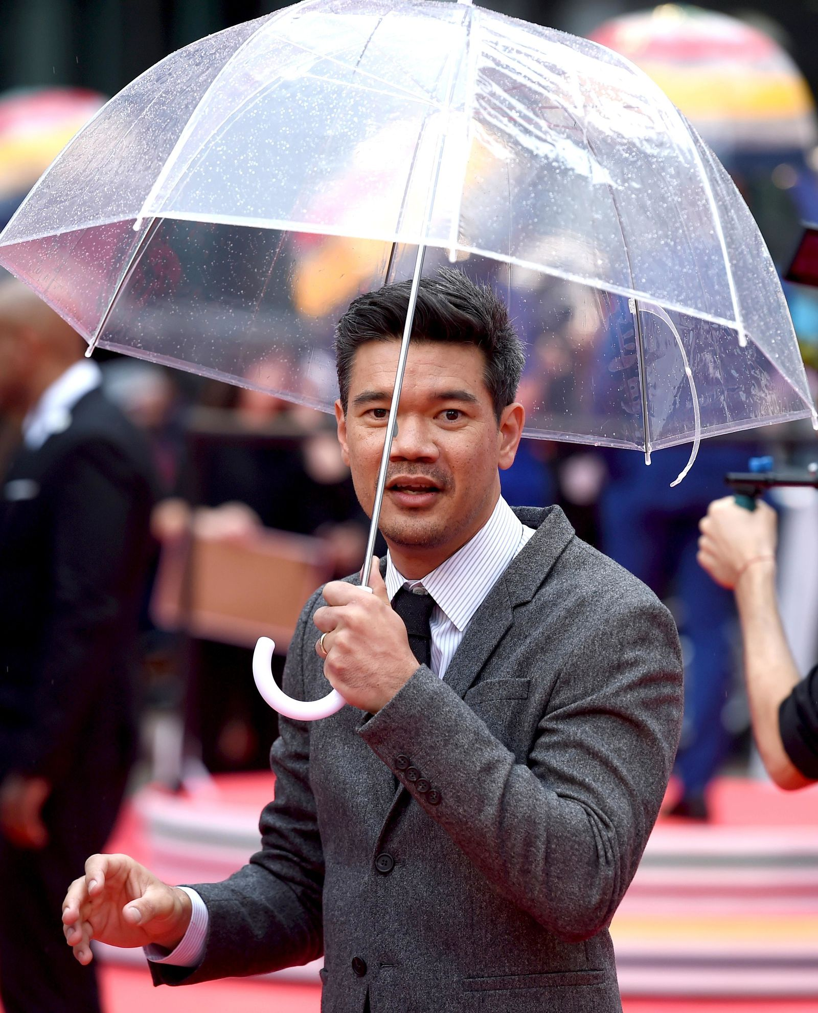 "Director Destin Daniel Cretton carries an umbrella as he attends the premiere for ""Just Mercy"" on day two of the Toronto International Film Festival at the Roy Thomson Hall on Friday, Sept. 6, 2019, in Toronto. (Photo by Chris Pizzello/Invision/AP)"