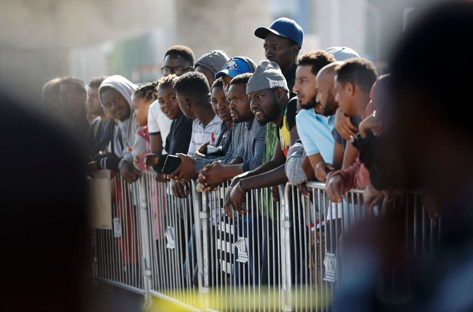 People wait to apply for asylum in the United States along the border Tuesday, July 16, 2019, in Tijuana, Mexico. Dozens of immigrants lined up Tuesday at a major Mexico border crossing, waiting to learn how the Trump administration's plans to end most asylum protections would affect their hopes of taking refuge in the United States. (AP Photo/Gregory Bull)
