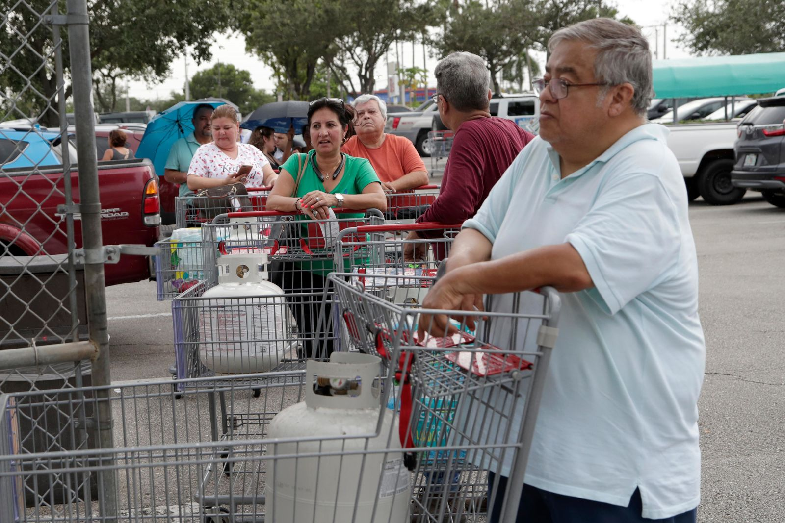 People stand in line for propane fuel at BJ's Wholesale Club in preparation for Hurricane Dorian, Thursday, Aug. 29, 2019, in Hialeah, Fla. (AP Photo/Lynne Sladky)