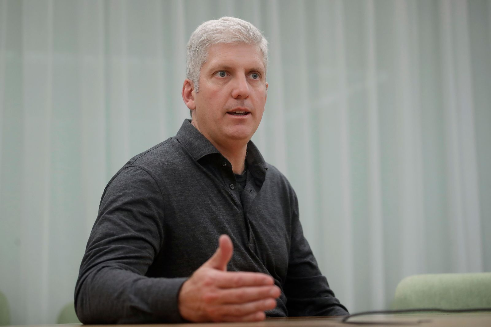 In this Tuesday, Sept. 24, 2019, photo Rick Osterloh, SVP of Google Hardware gestures while interviewed in Mountain View, Calif. (AP Photo/Jeff Chiu)