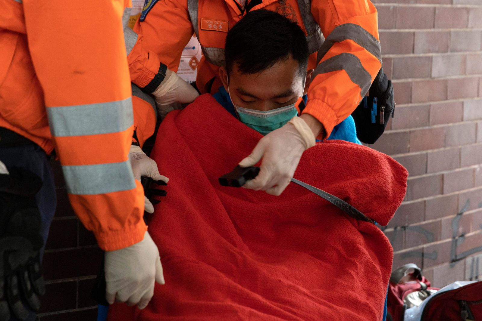 A man is evacuated by medics from the Polytechnic University in Hong Kong on Wednesday, Nov. 20, 2019.{ } (AP Photo/Ng Han Guan)
